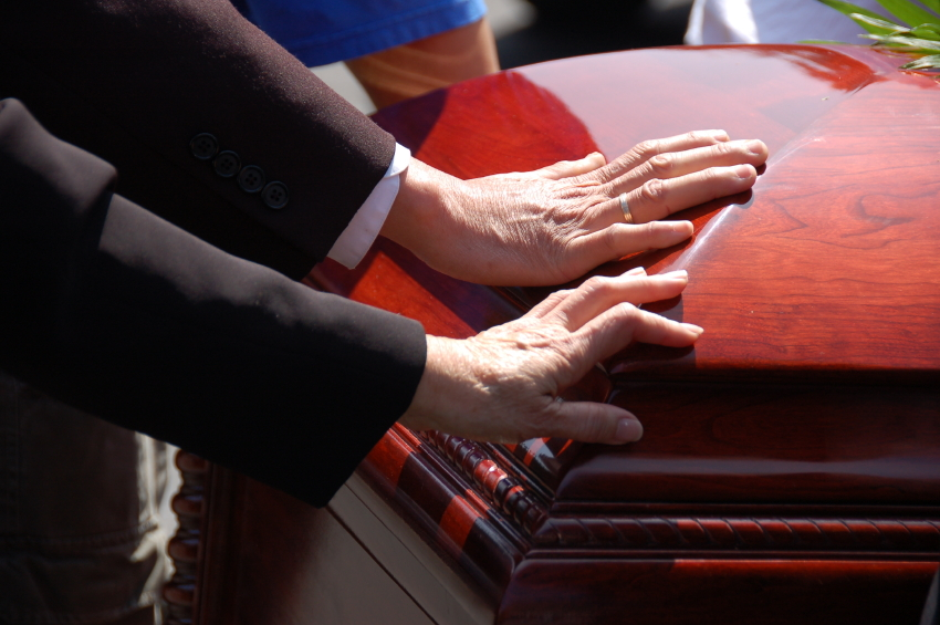 hand on coffin